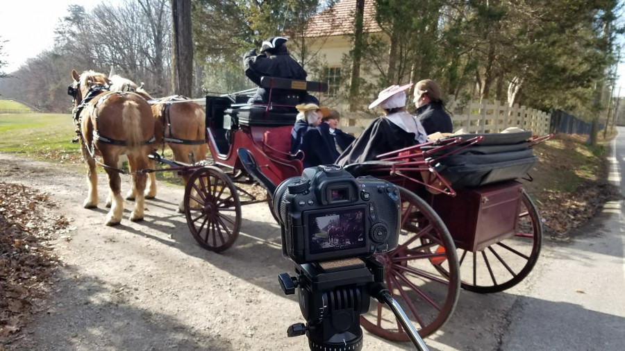 Filming the Washingtons arriving at home.