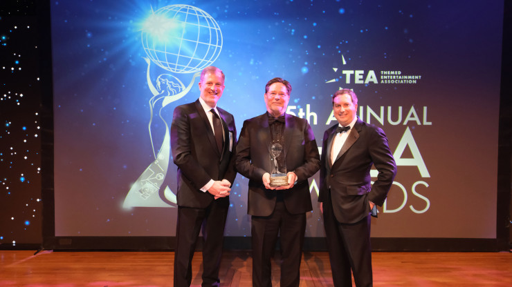 From left: Rob Shenk, Joe Cortina, and Matt Briney accept the Thea Award at an awards ceremony on April 13.